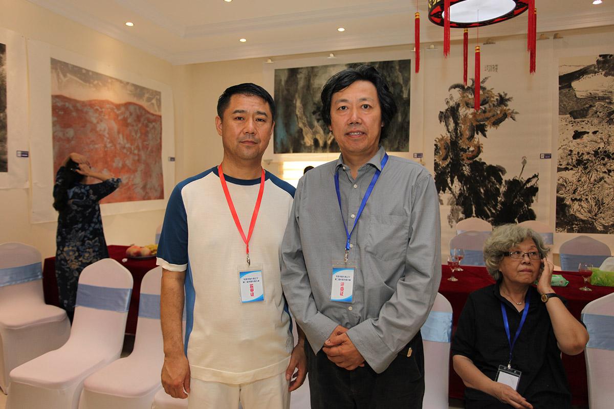 昌宇集团董事长李刚-中国美术家协会艺术中心主任丁杰