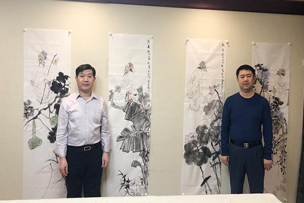 左北京市美术家协会副主席 贺成才 右昌宇集团董事长李刚