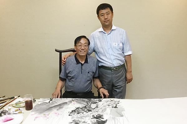 昌宇集团董事长李刚与著名画家杨海滨
